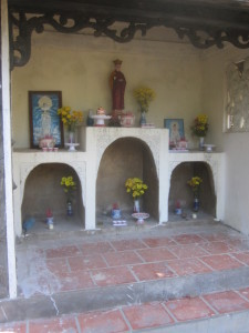 The shrine at the well in memory of the slain girl.